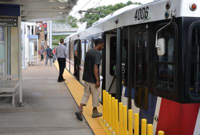 People board MetroLink train at Clayton station, 7/21/17
