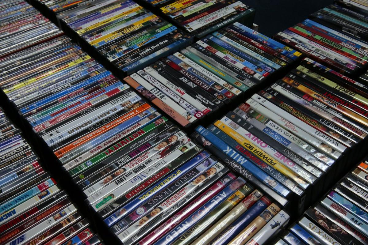 DVD lovers seek the tangible, keep stores afloat. 'I just buy ...