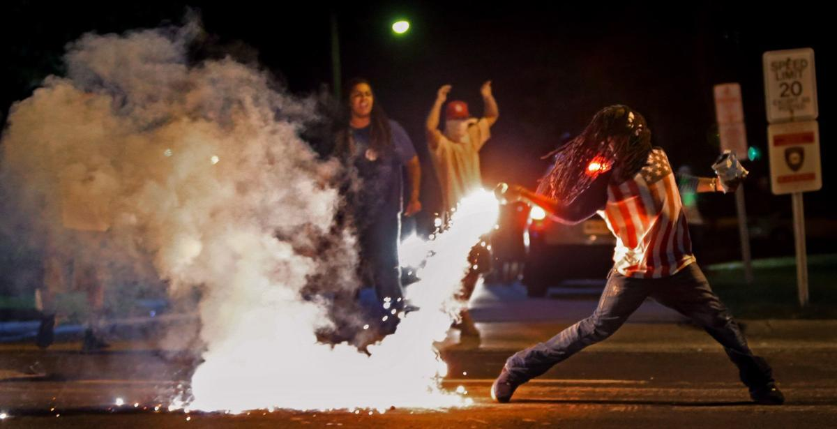 Quieter night in Ferguson ends again with tear gas