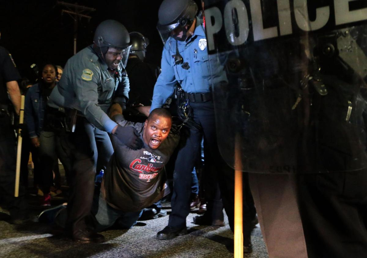 More than 150 demonstrators protest in front of Ferguson Police Station
