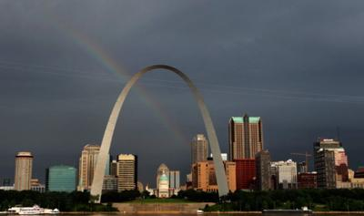 Arch offers one last rainbow picture over downtown