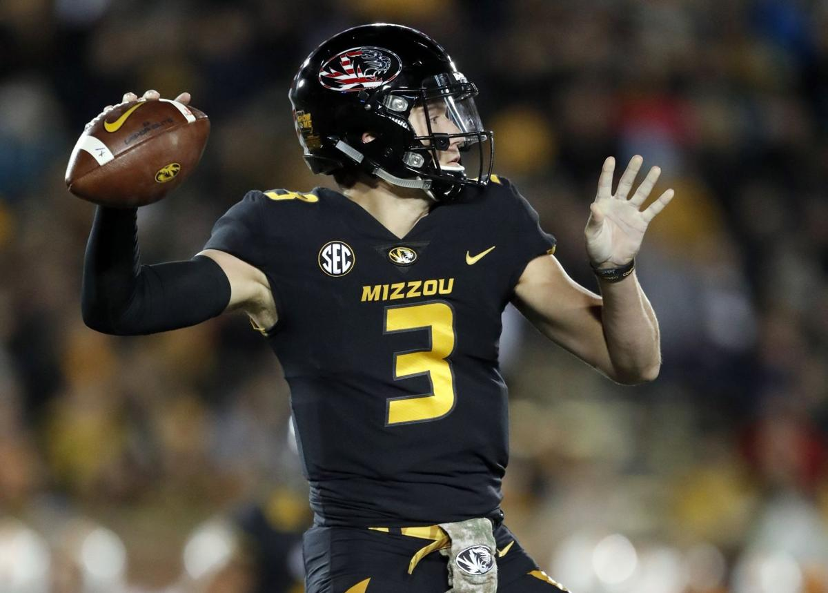 Record-setting Drew Lock await Longhorns, weighs his ...