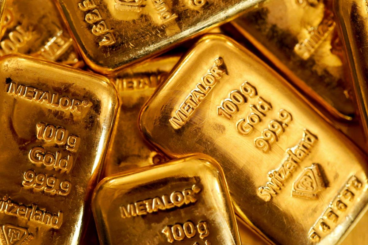 Gold gains as palladium surges past $1,500 for the first time
