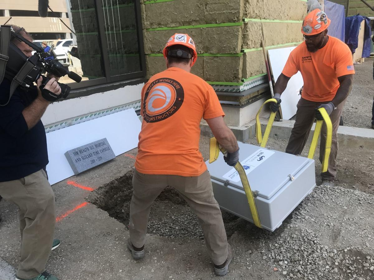 Time capsule burial at new St. Louis University Hospital