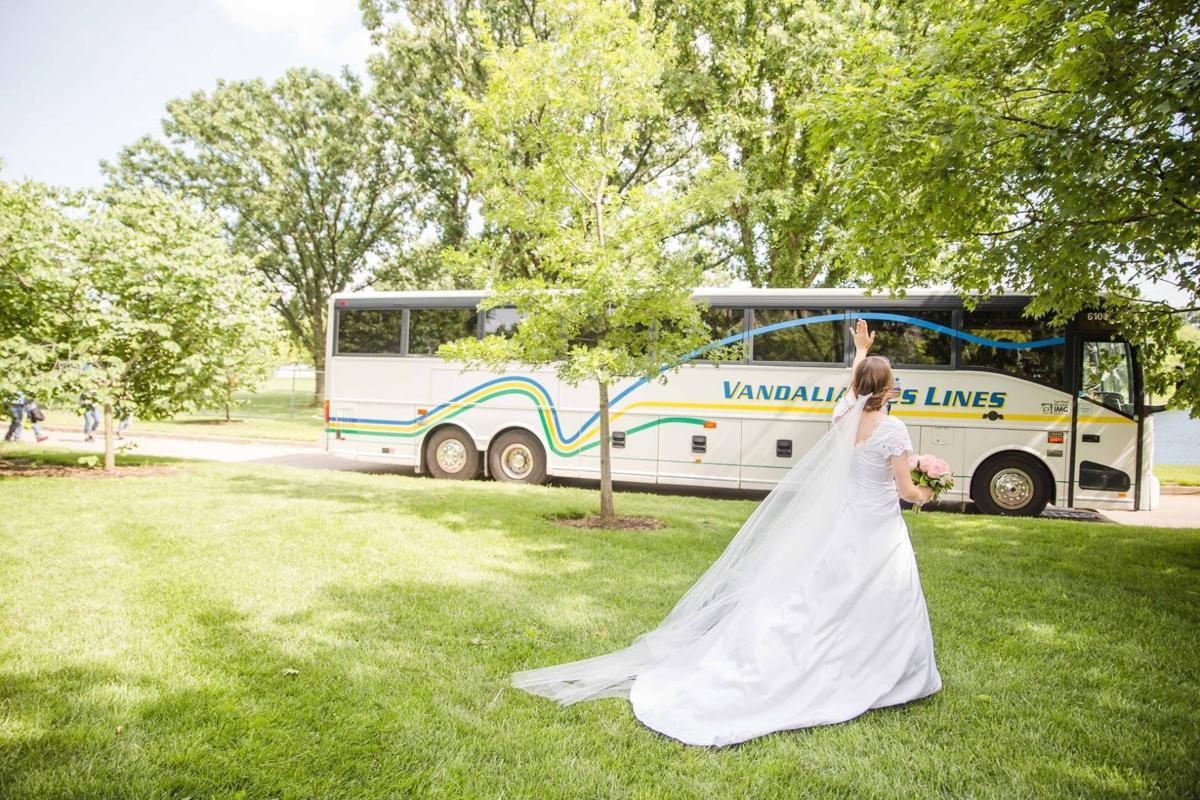 Margaret Comeau chases Blues' bus