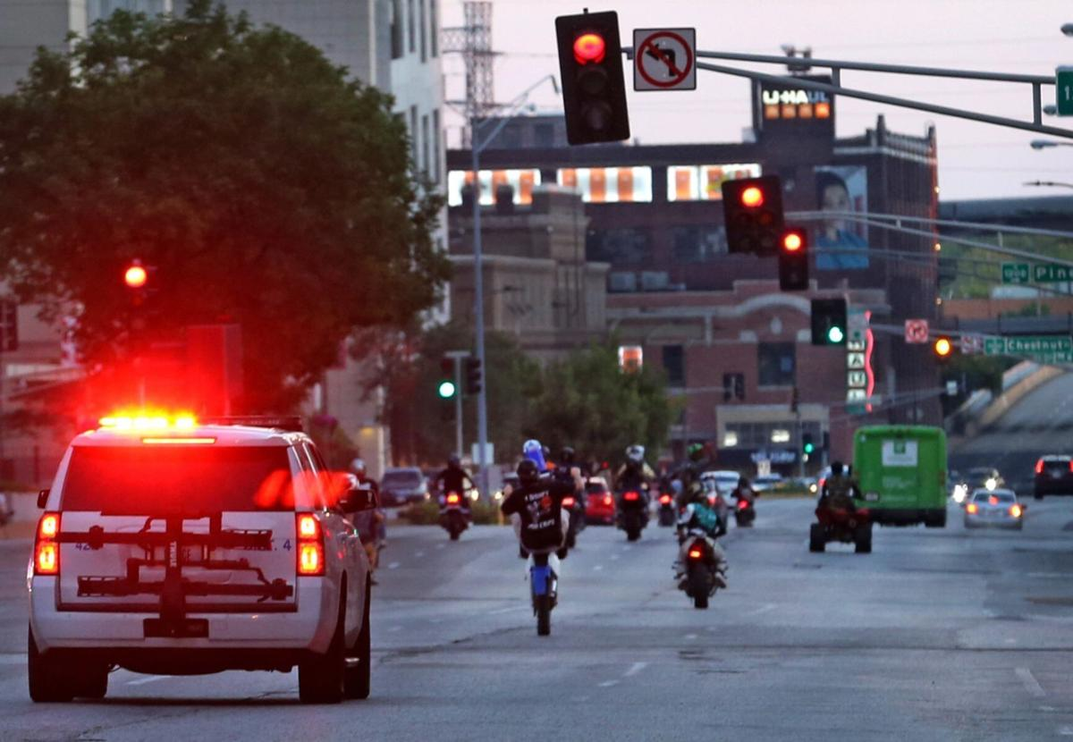 Police try to stop street racing and mayhem downtown