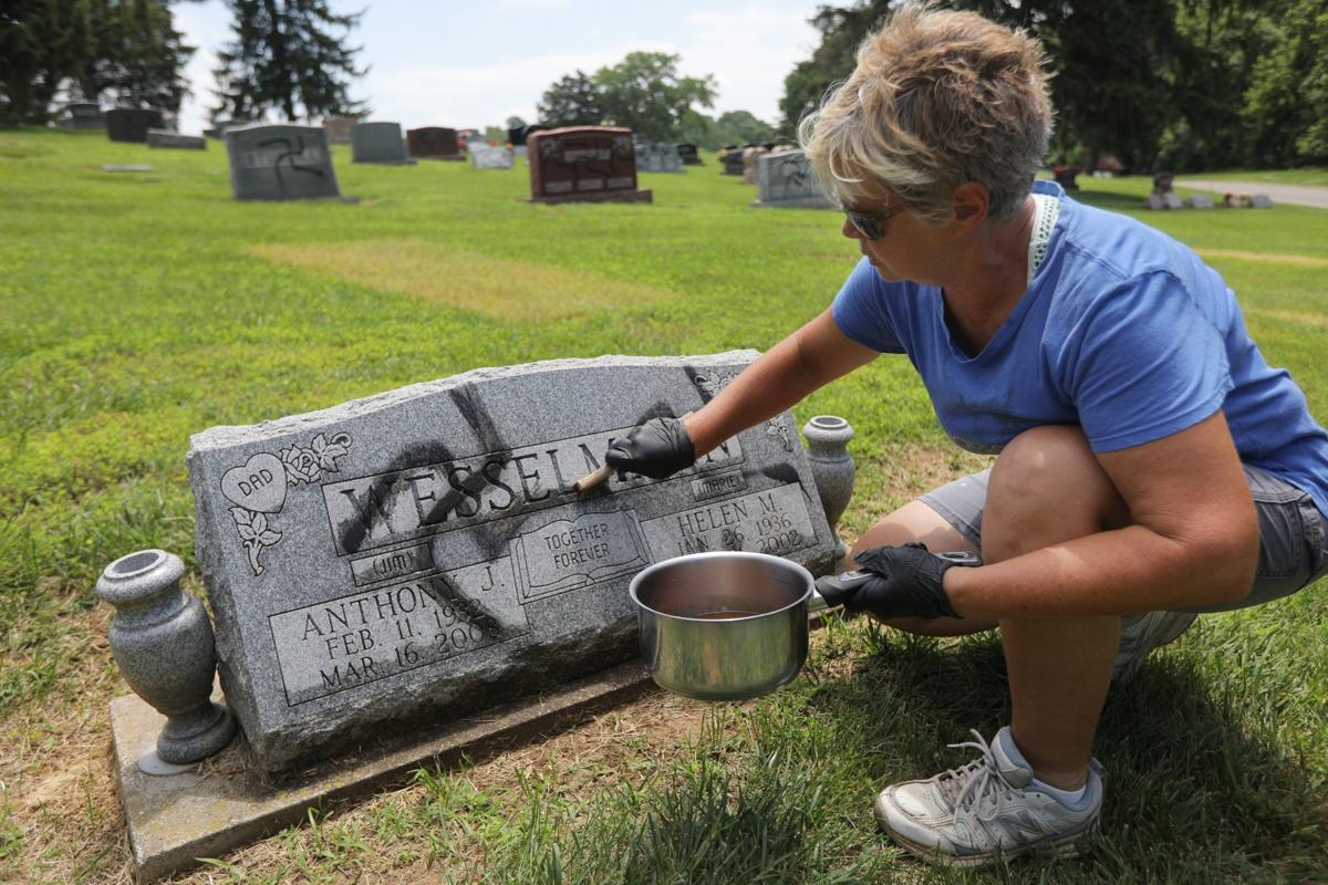 Vandal spray-paints swastikas 150 to 200 headstones and markers
