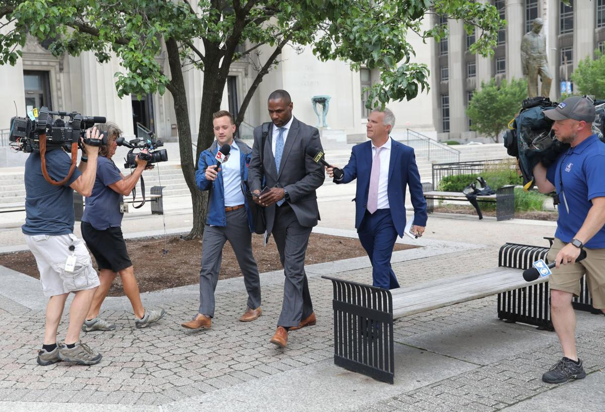 Attorney Jermaine Wooten representing former FBI agent William Don Tisaby leaves court