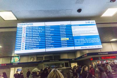 A digital Amtrak and NJ Transit departure board in Penn Station in New York on Jan. 23, 2017. Amtrak is implementing new personal safety measures to protect passengers in the era of COVID-19.
