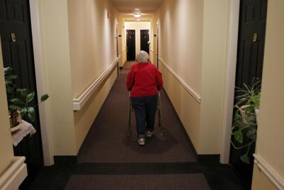 FILE PHOTO: Inez Willis walks down the hallway to visit a neighbor at her independent living complex in Maryland