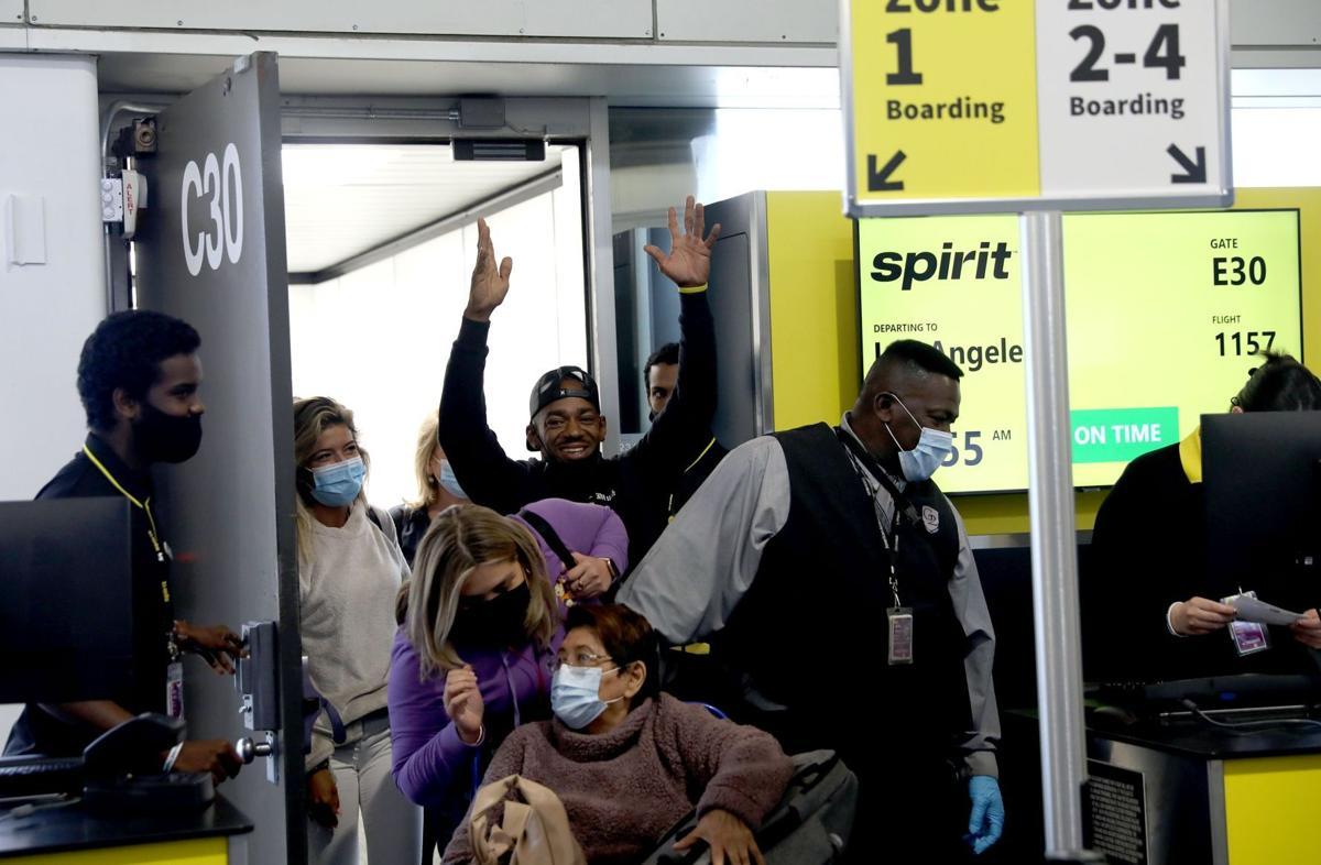 Crowd cheers as first Spirit arilines flight lands in St. Louis