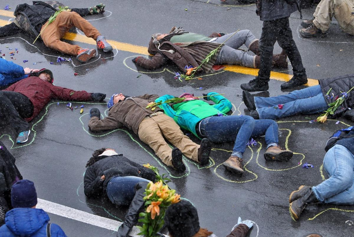 "Protesters stage a ""die-in"" in the Delmar Loop"