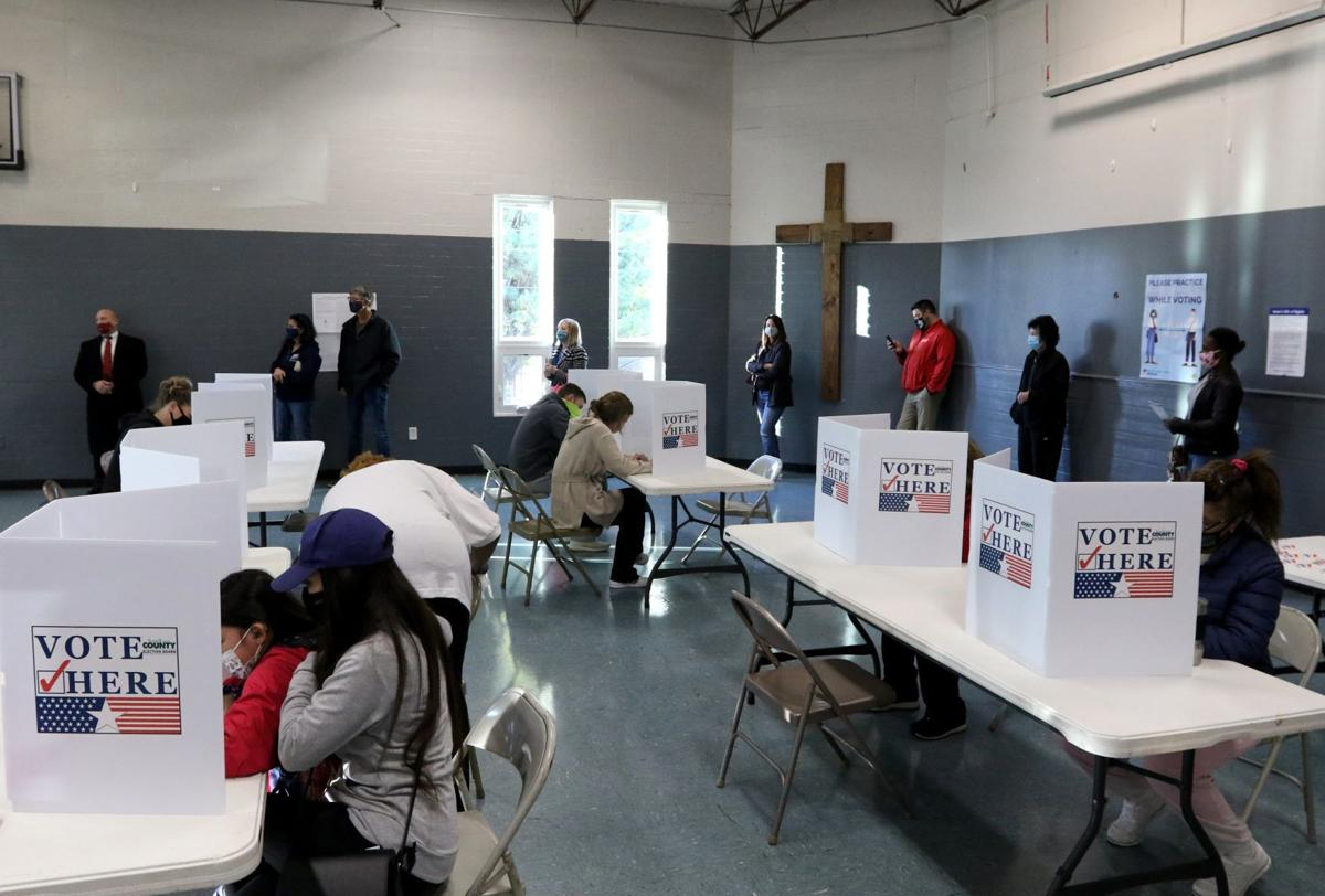 Voters wait at Have Bible Will Travel church