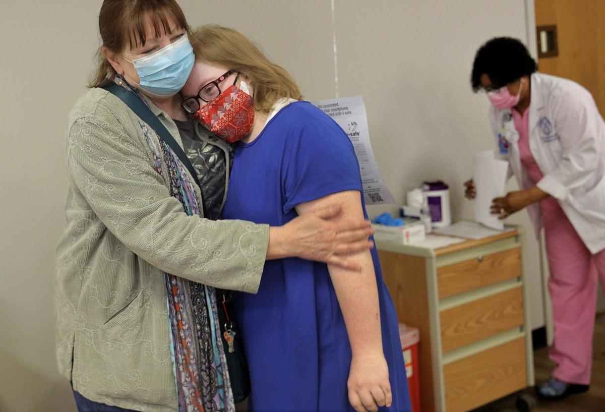 Adults with Down Syndrome, caregivers receive vaccines