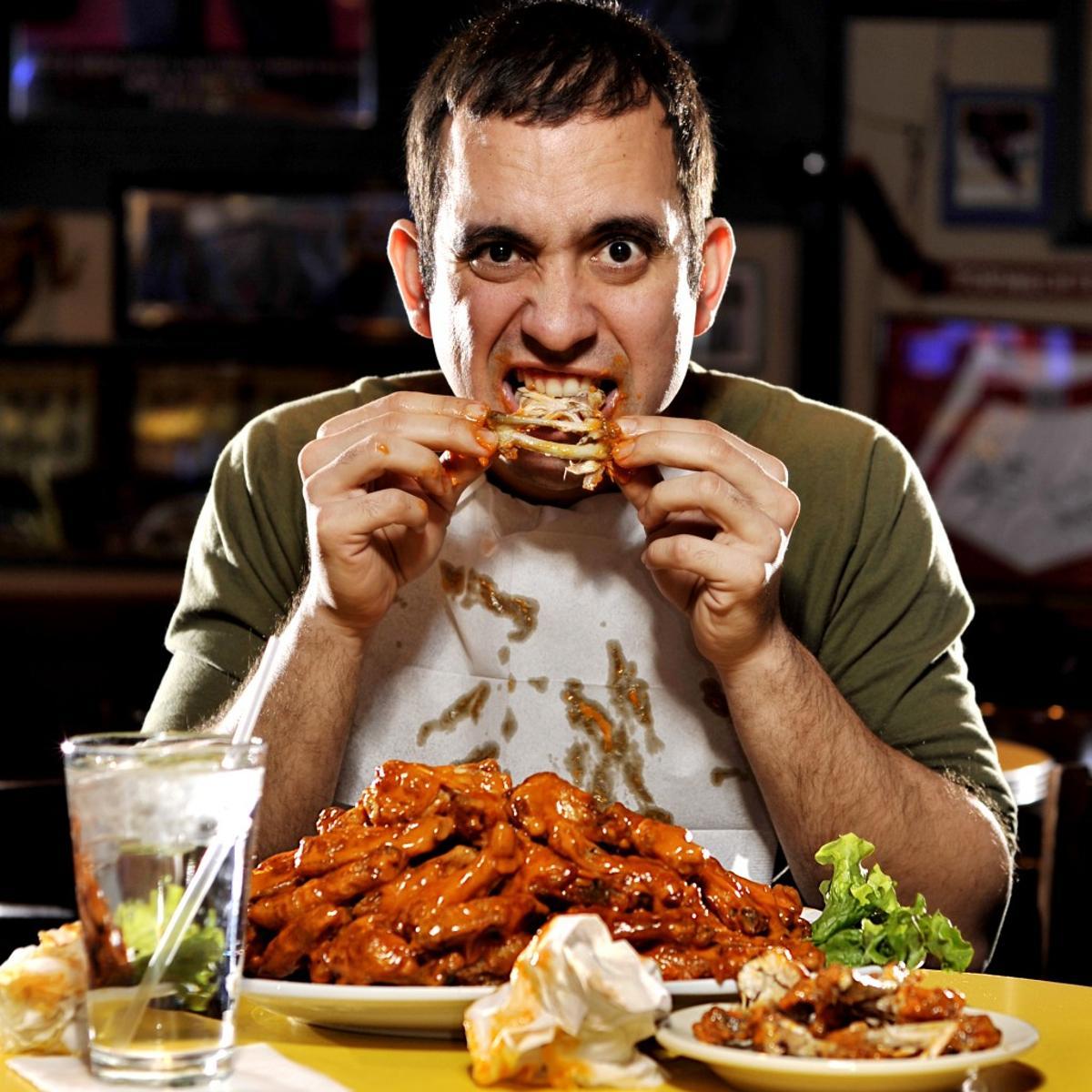 Man eating chicken wings