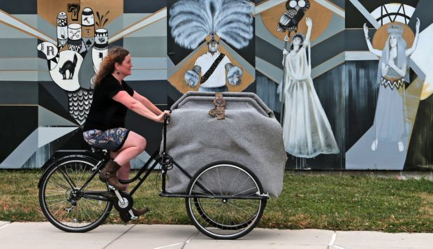 Artist Ilene Berman and her tricycle-powered mobile art studio Room13Delmar - riding in Grand Center