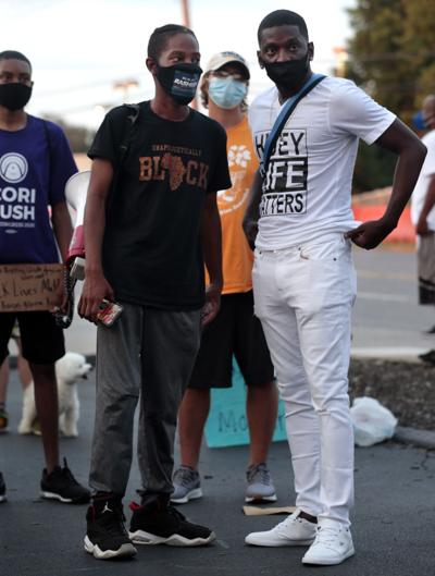 Protesters march in Florissant
