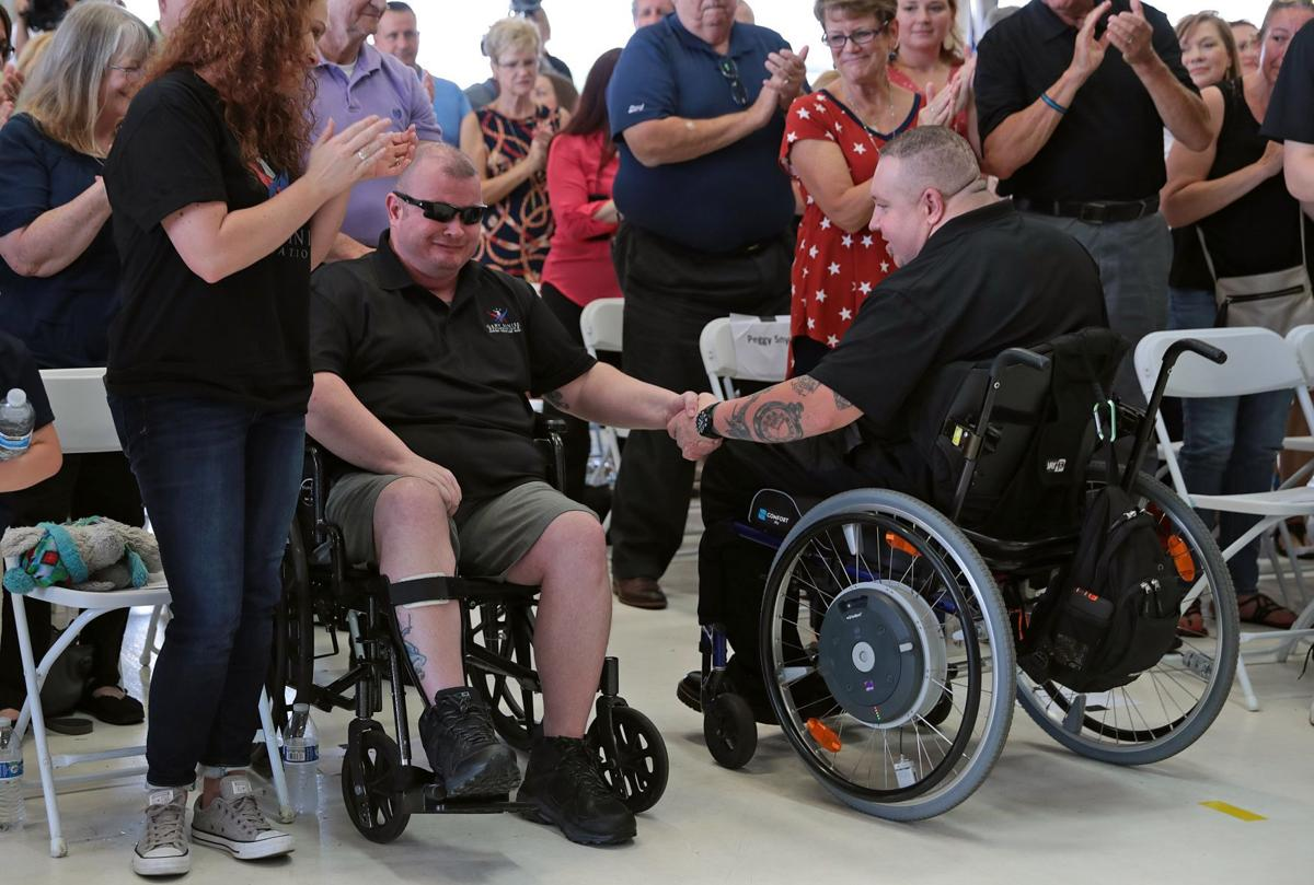 Injured officers Mathew Crosby and Ryan O'Connor to receive specially adapted homes
