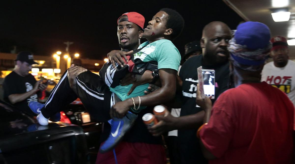 Man hit by car, shots fired at Michael Brown protest