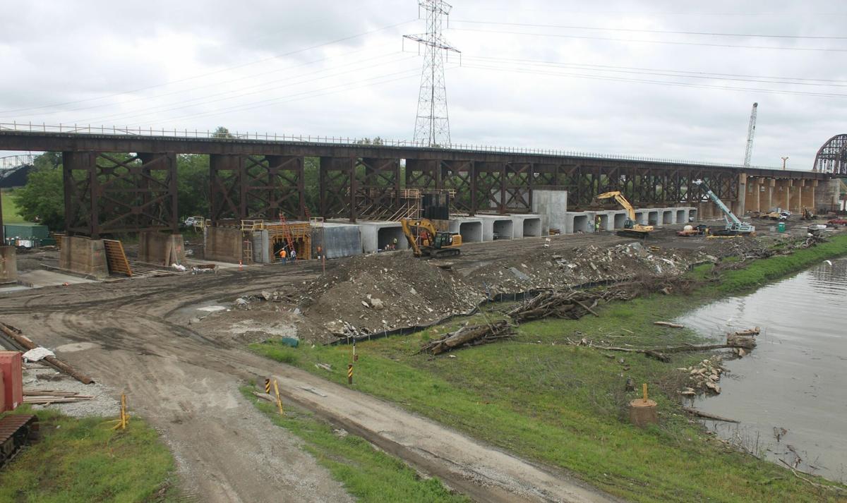 Crews work on a section of Merchants Bridge