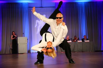 Emerson Senior Vice President Mark Bulanda and his dance partner, Angie Brooks, performing during the 2018 Dancing with the St. Louis Stars event.