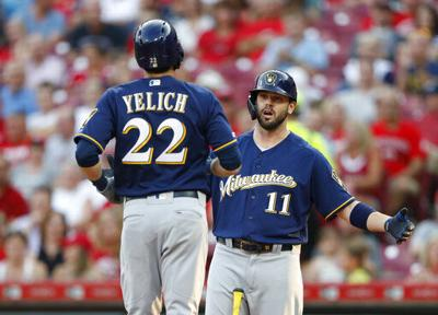 Yelich hits 31st homer; Reds beat Brewers 5-4 in 11 innings