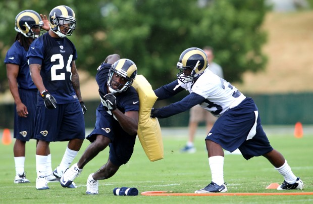 Wide Receiver Brian Quick (83) explodes off blocking drill