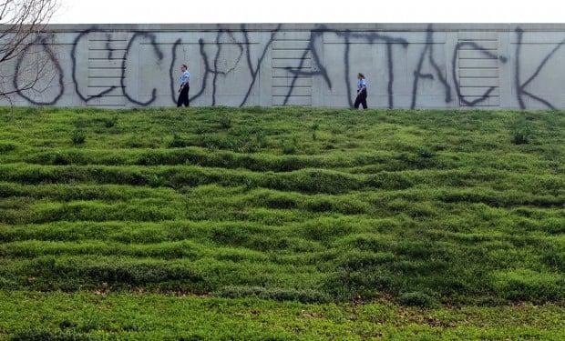 Vandalism at Compton Hill Reservoir Park- St. Louis Police walk along vandalized wall