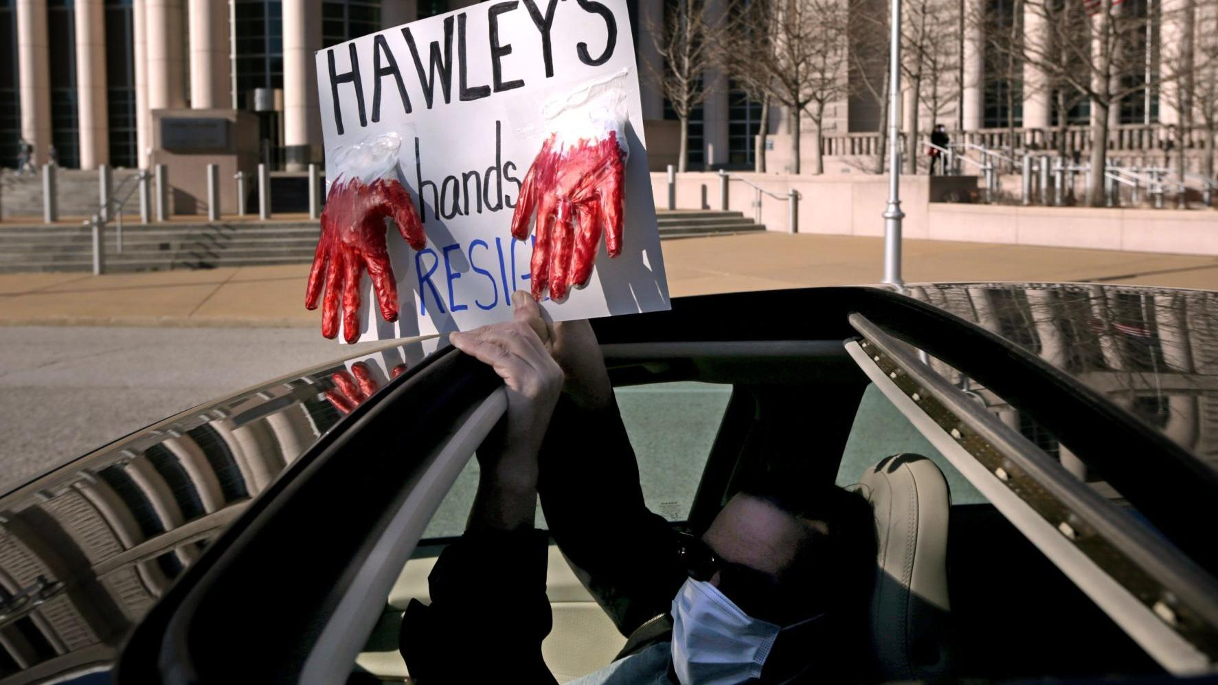 Protesters say Hawley has 'blood on his hands' and should step down