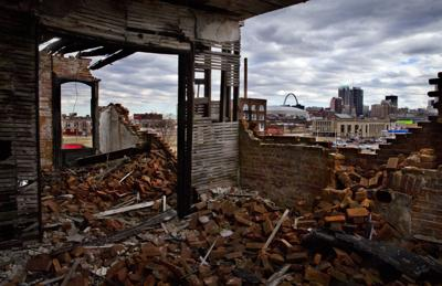 Building on 14th Street, burned years ago, slowly disintegrates
