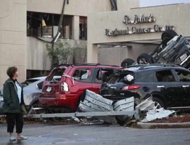 Woman looks at damage at Joplin hospital after tornado
