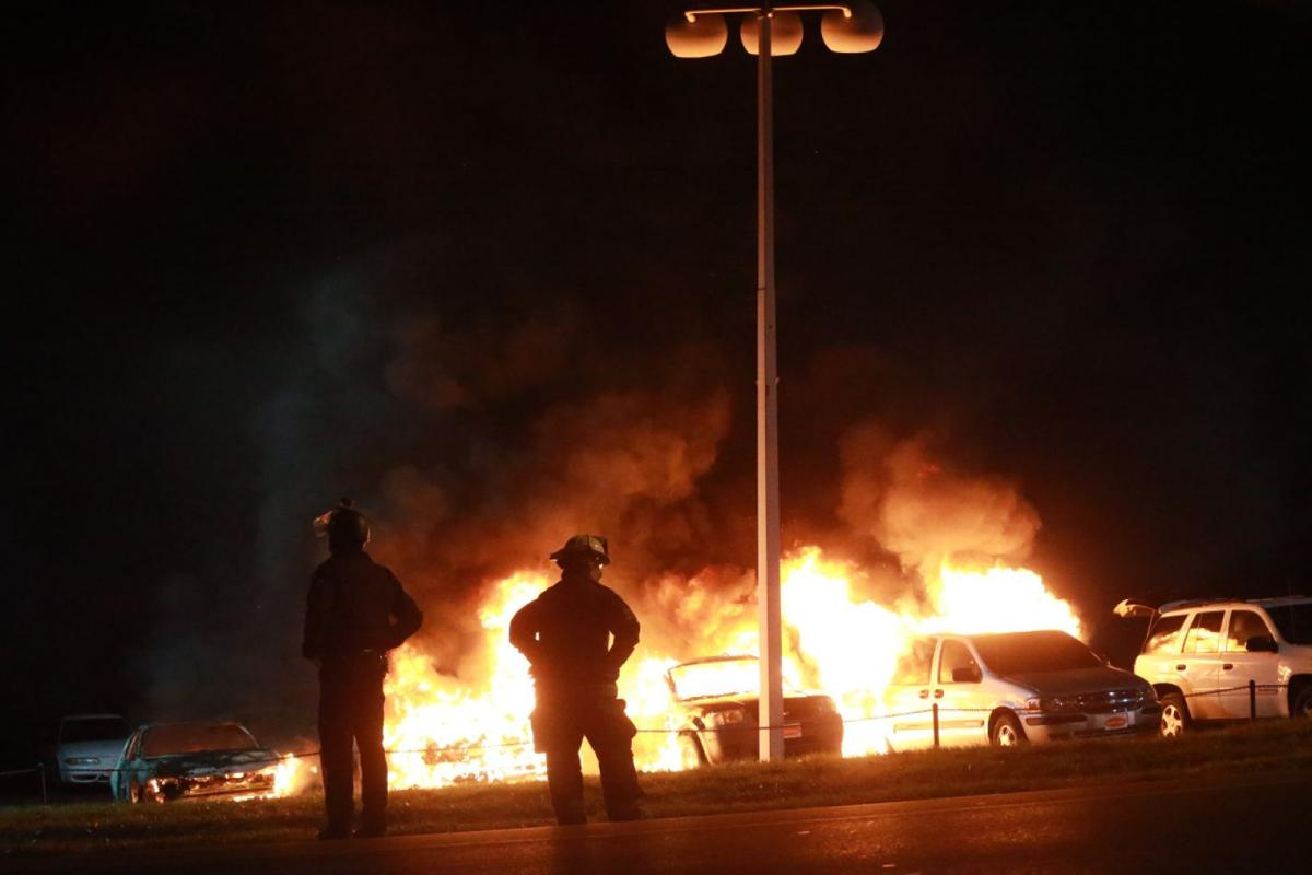 IN FERGUSON: Businesses burn, police cars torched as violence 'much