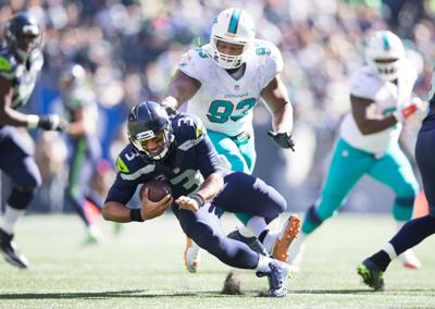 2babf6e2c Dolphins Seahawks Football. Miami Dolphins defensive tackle Ndamukong Suh  (93) steps on Seattle Seahawks quarterback Russell Wilson s foot in the ...