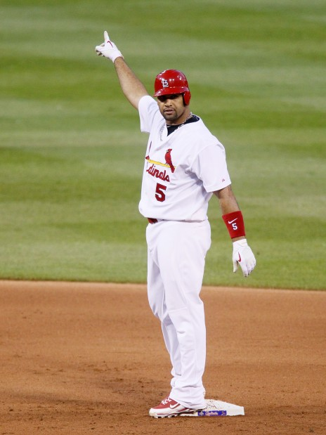 """Pujols points to his """"homer"""""""