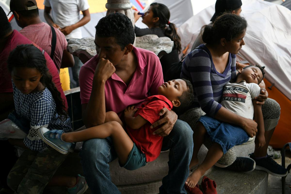 FILE PHOTO: Honduran asylum seekers sent back to Mexico from the U.S. under Migrant Protection Protocols (MPP) pass the time at a makeshift encampment in Matamoros