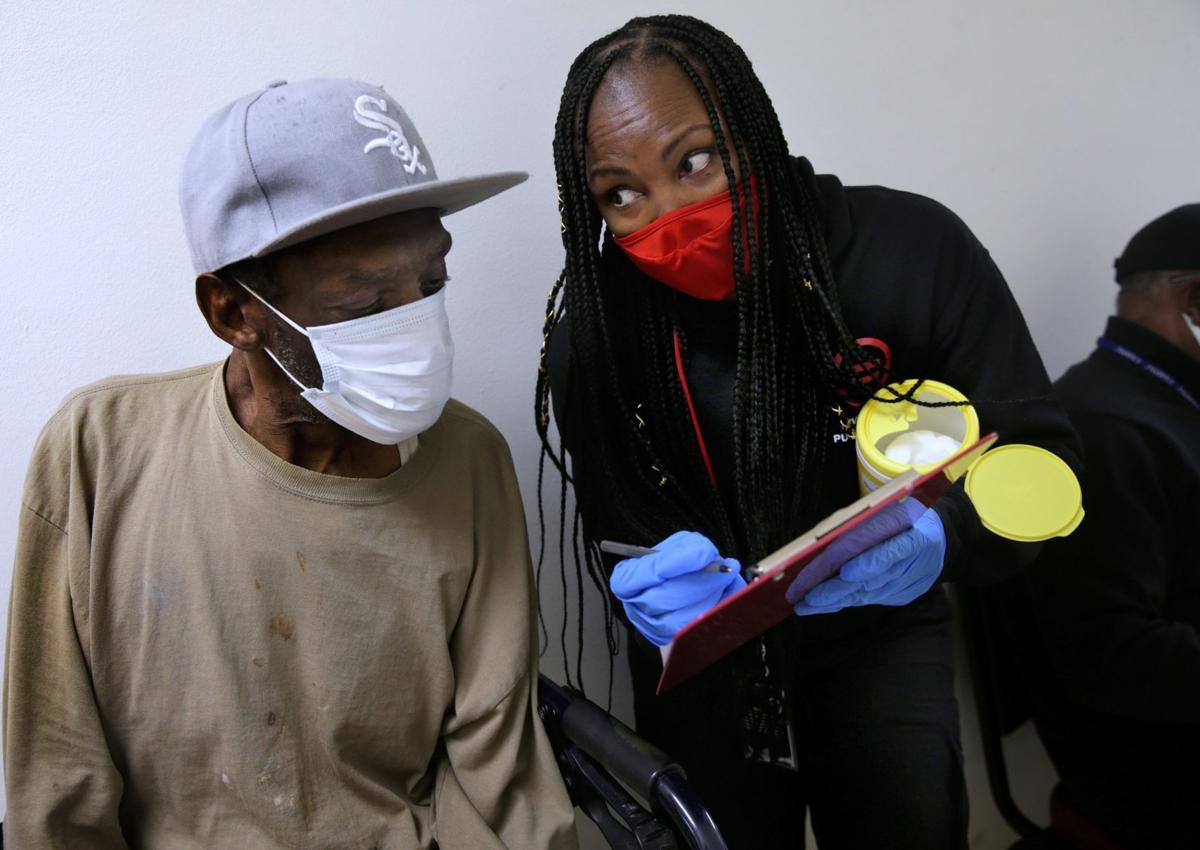 Urban League outreach worker Kilea Wise helps resident Nathaniel Martin