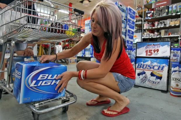 Lindsay Peel buys a case of Bud Light