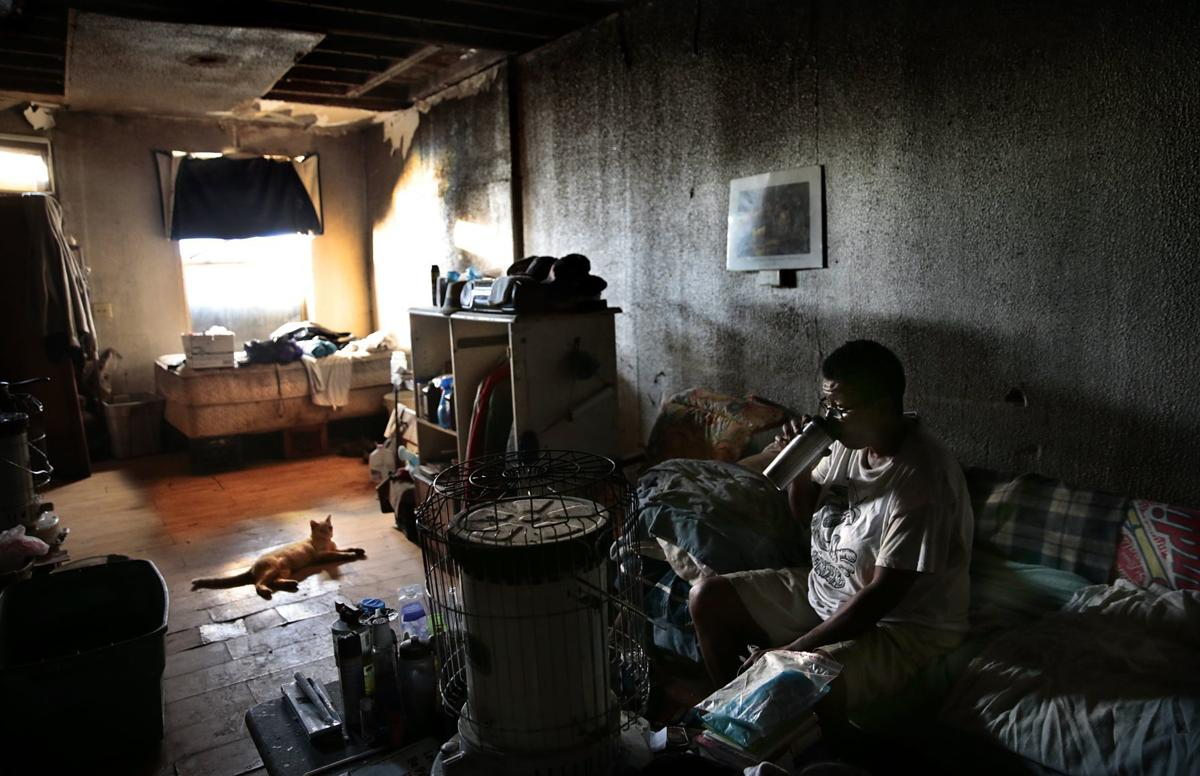 Crumbling walls of vacant homes reveal lives unseen