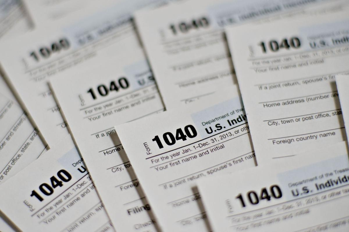 Illinois income tax rate ends up being higher than missouris us department of the treasury internal revenue service irs 1040 individual income tax forms for the 2013 tax year are arranged for a photograph in falaconquin