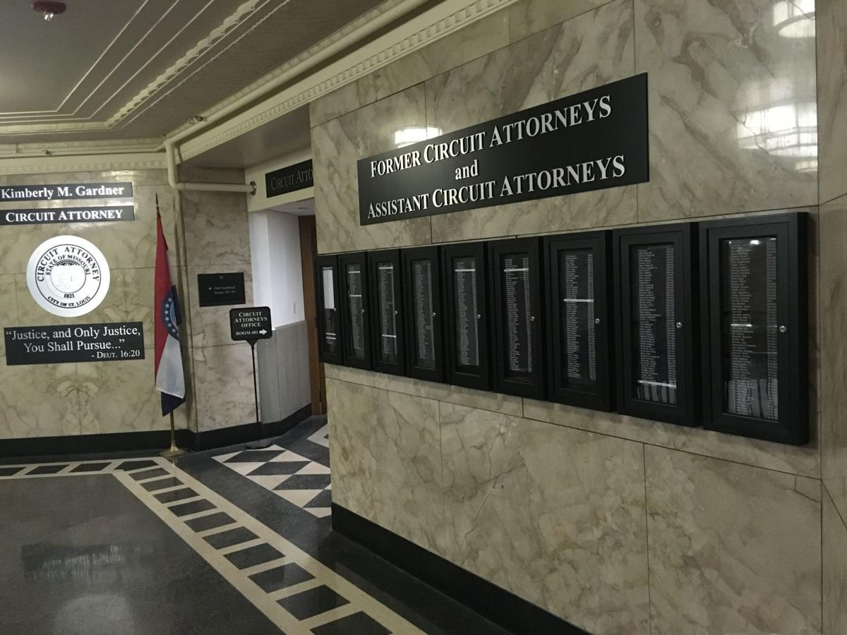 Glass cases list former prosecutors in the Circuit Attorney's Office
