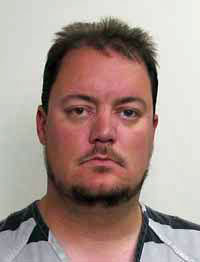 Former Alton band director pleads guilty of assaulting student