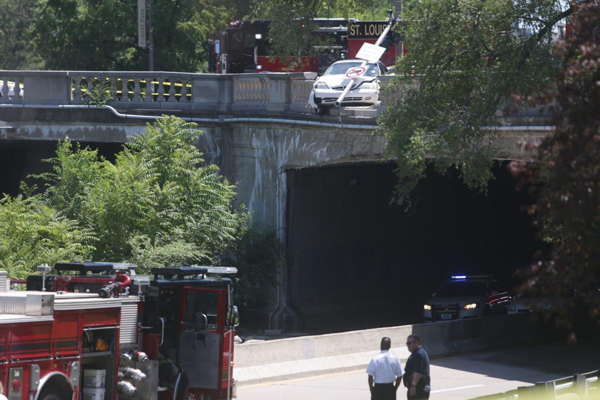 Woman killed when falling concrete topples on car in 'freak