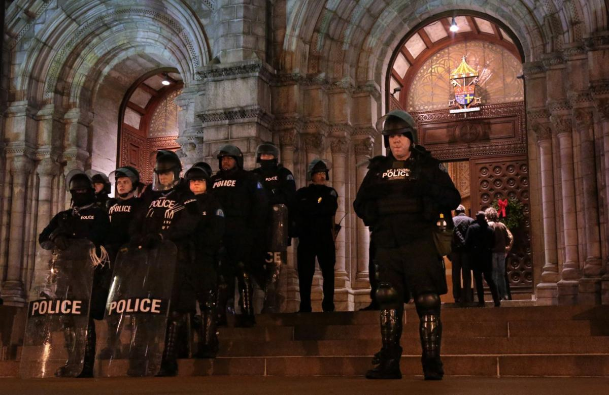 Protest held at Cathedral Basilica for Midnight Mass