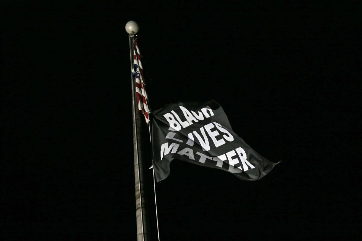 Protesters flag flies over Florissant Police Station