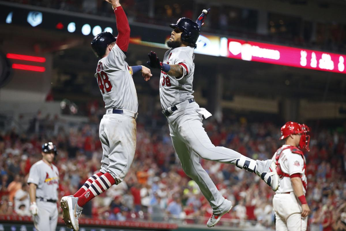 Cardinals rock Reds with 10-run inning and hold on tight for 12-11 victory