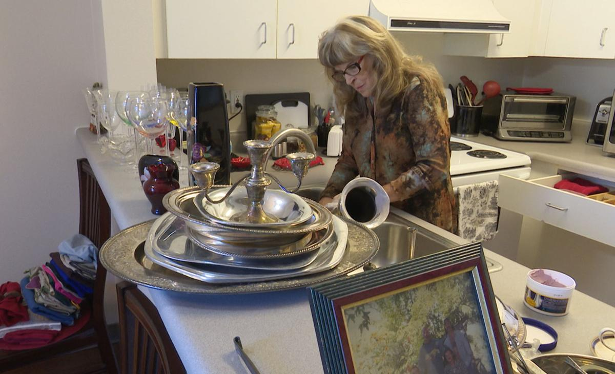 Gayle McCormick works in her kitchen in this still photo taken from video, inside her new apartment in Bellingham