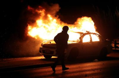 Protesters burn county police car in Ferguson after grand jury decision