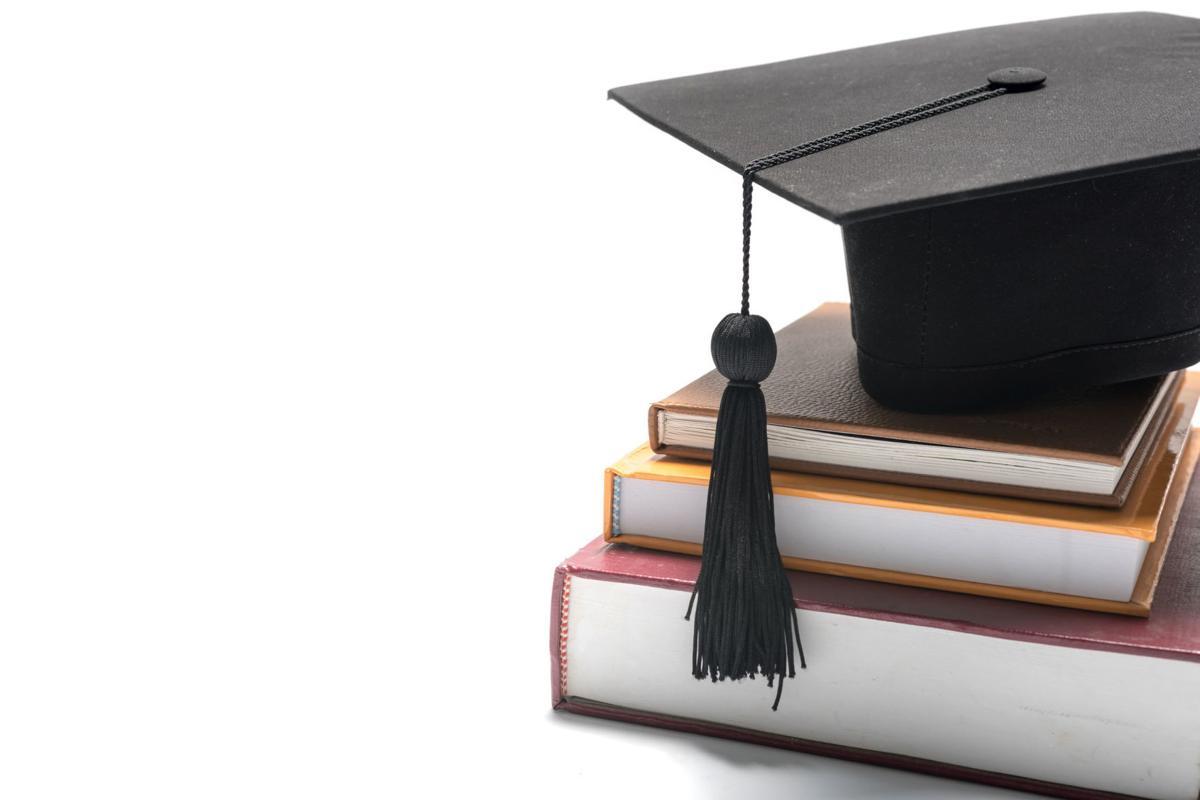 Graduation cap, books