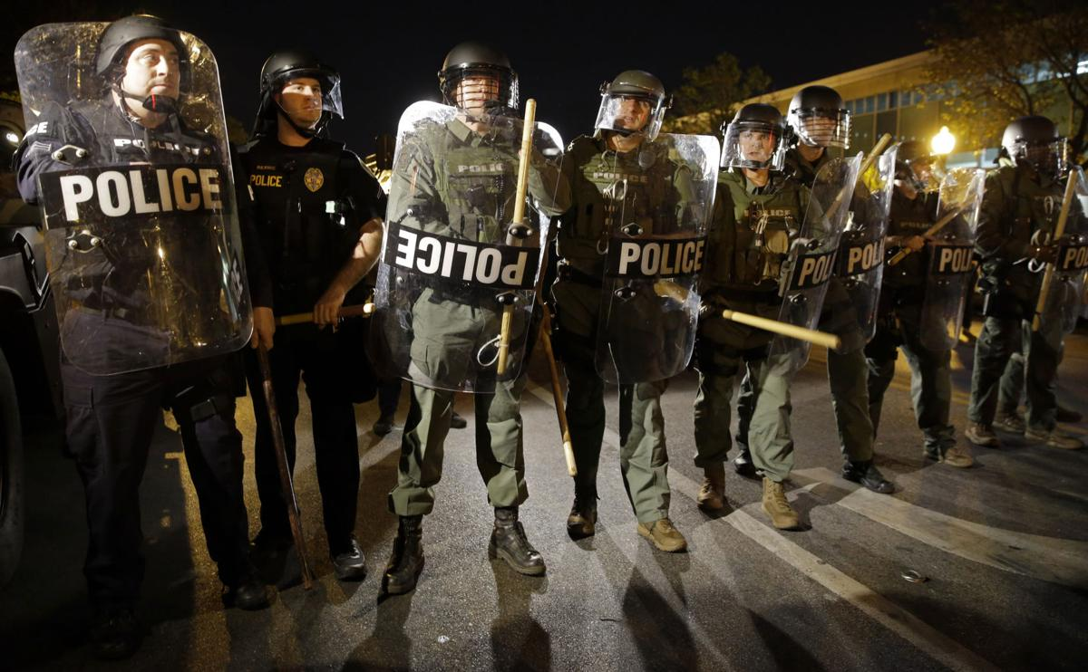 Federal report blasts Baltimore police over bias, force