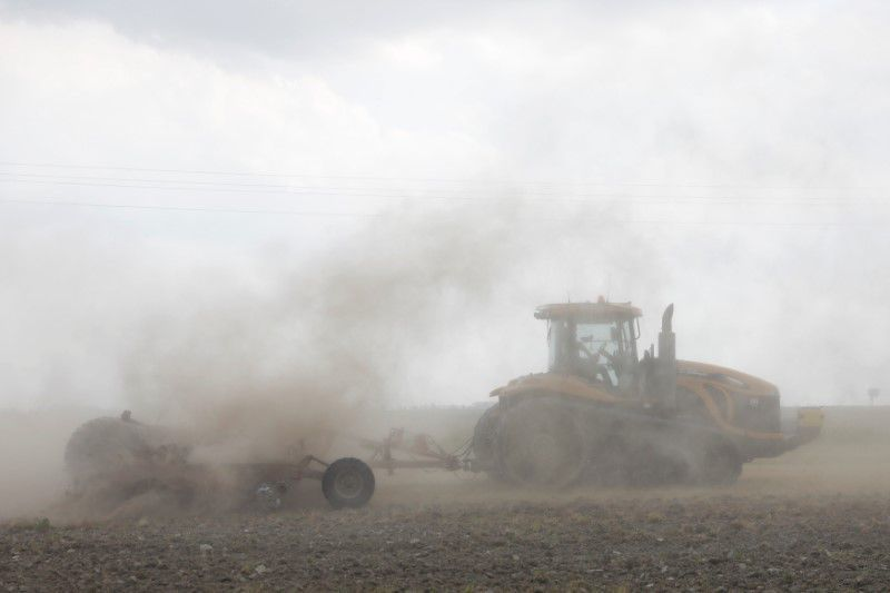 A tractor tills the ground for soybeans in Gideon, Missouri